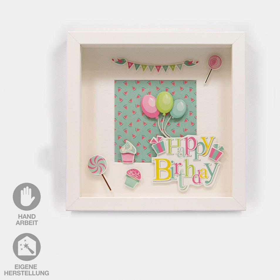 """Geschenk-Idee im Rahmen zum Geburtstag. Weißer Rahmen mit farbigem Hintergrund, Schriftzug """"Happy Birthday"""" und Luftballons in pink, grün und blau"""