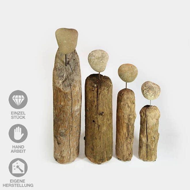 In Handarbeit gefertigte Familie (4) aus Treibholz mit Steinköpfen