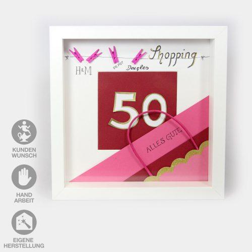 """Sonderanfertigung eines Shopping-Gutscheins zu einem 50. Geburtstag. Weißer Rahmen mit einer großen """"50"""" auf rotem Grund und pinken Shopping-Applikationen"""